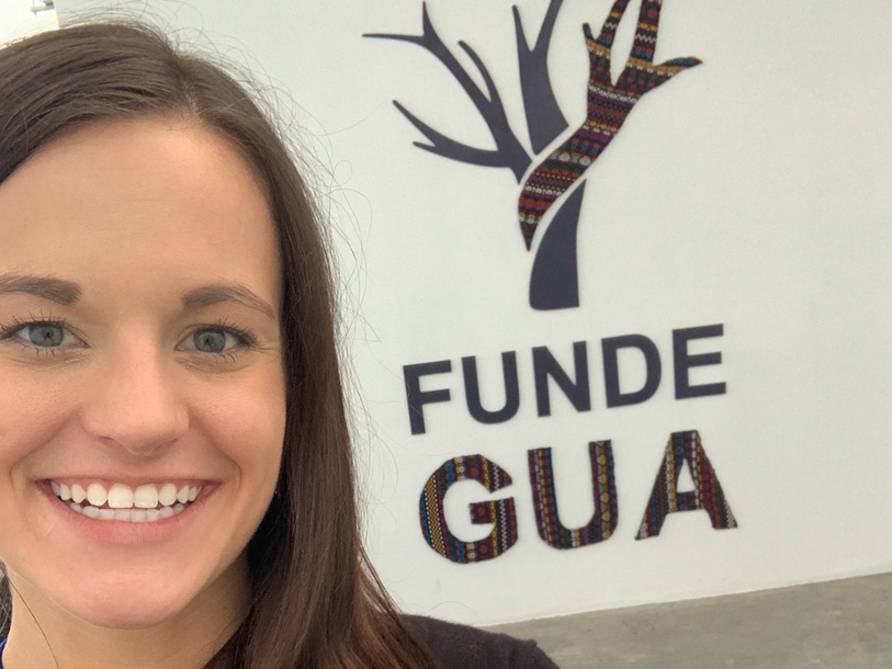 Kelsey Landrum stands in front of FUNDEGUA, one of the organizations that she and her research group collaborate with in Guatemala City.