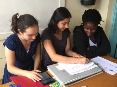 Suzanna Larkin and Emma Mehlhop carry out a questionnaire with a nursing officer in the Migori county of Kenya.