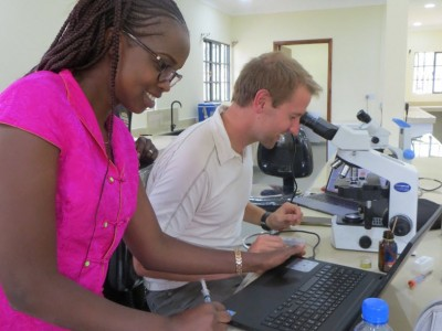 Tabitha Jepkurgat and Cody Nelson set up microscopes in PEARL