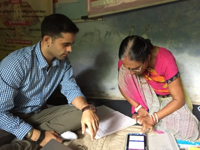Aditya Mehta trains an Anganwadi worker