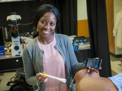 Mercy Asiedu with Pocket Colposcope