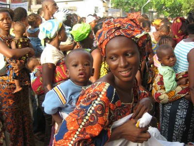 This mother and baby in Sierra Leone are among hundreds waiting in line at 8am for a children's hospital to open.