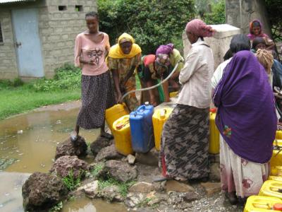 Women pumping water