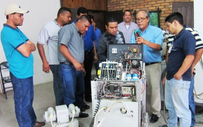 As part of the Duke BMET program, Jerry Kaufman instructs Honduran students on the repair and maintenance of a vintage X-ray machine.  The machine dates back to the 1950's, but had been in use until recently