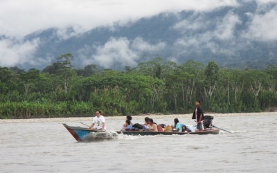 Personnel from the Ministry of Health and Duke fieldworkers returning from Palotoa Teparo with a mother and her sick infant