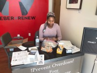Autumn Barnes sits at the front desk of Project Weber/RENEW assembling Narcan kits.