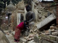 Elderly Woman Praying in Temple