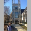 Joshua Rivenbark stands in front of the Sanford School of Public Policy at Duke (before the COVID-19 pandemic).