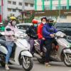 Commuters in masks in Hanoi, Vietnam, April 2020